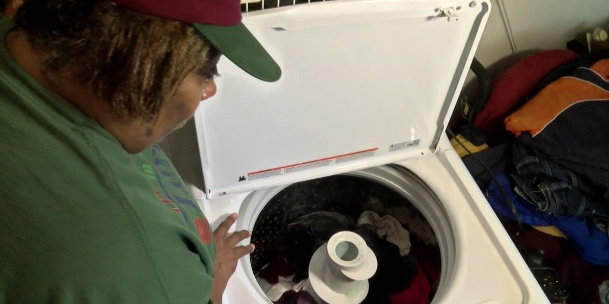 Woman calls 12 after business takes back broken, brand new washing machine, gives her $22
