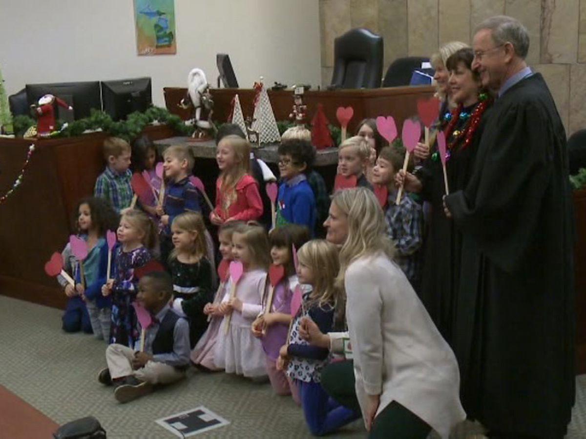 Michigan boy brings kindergarten classmates to adoption ceremony