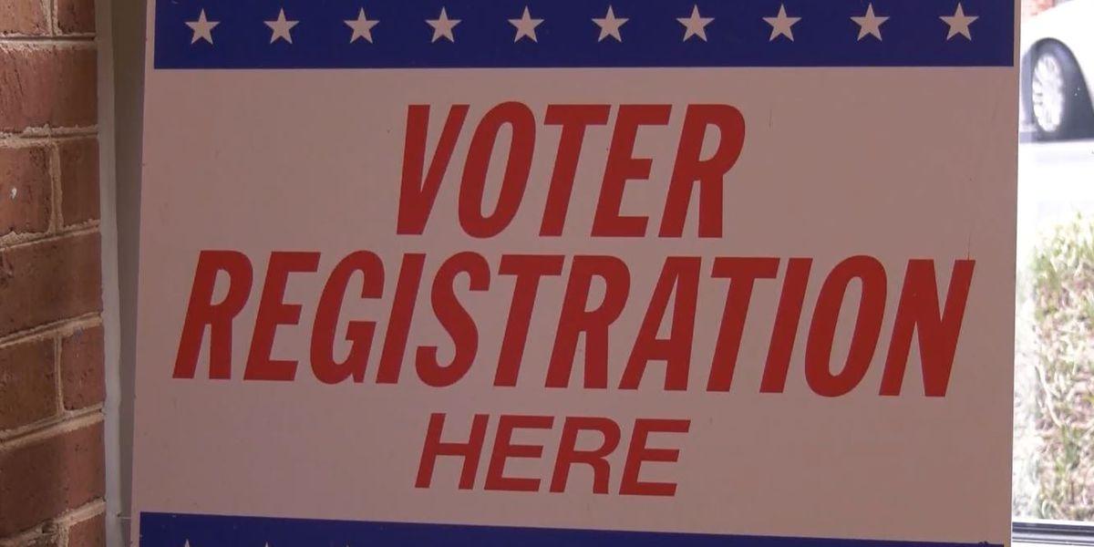 Virus prompts drop in new voter registrations in Virginia