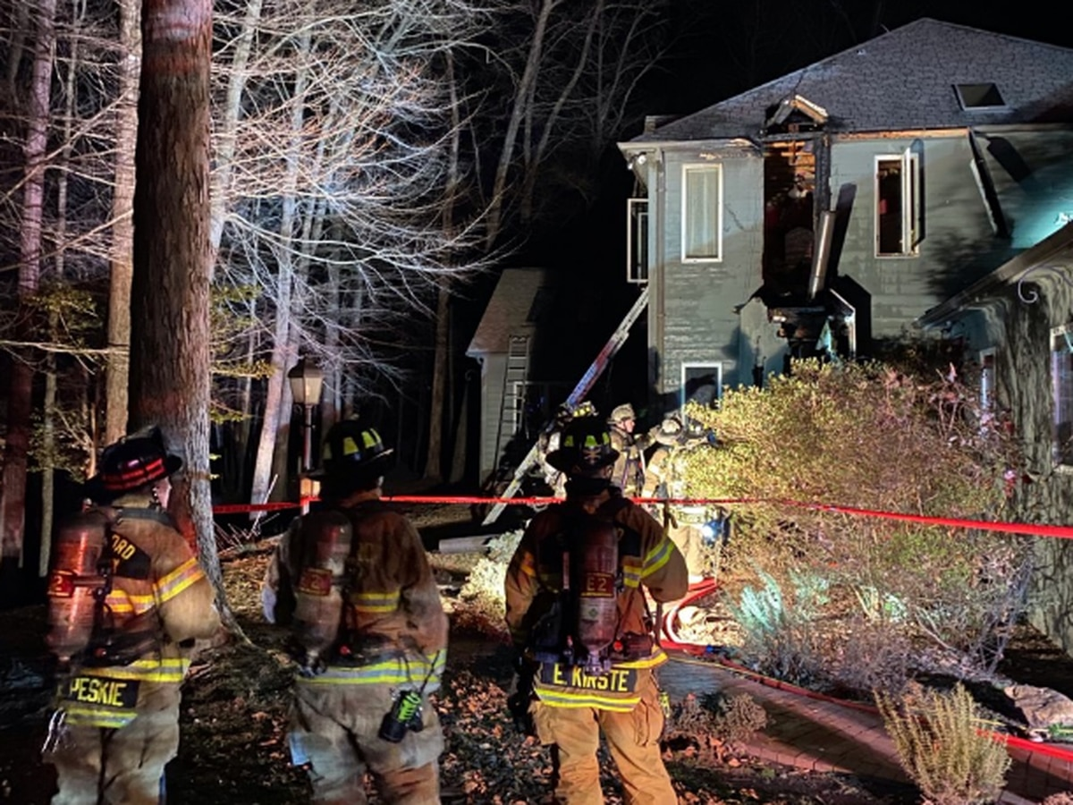 Two displaced after house fire partially collapses chimney