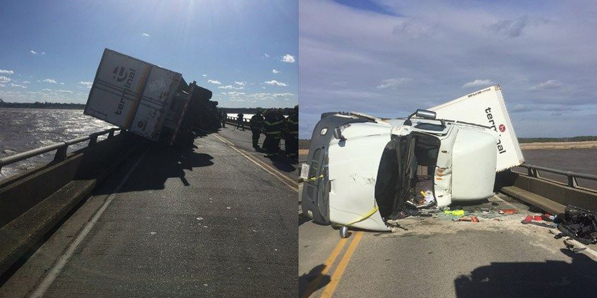 Wind blows tractor-trailer truck onto car, shutting down bridge