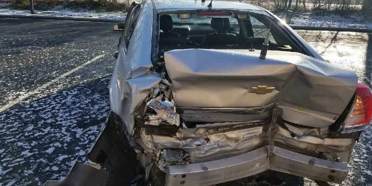 State police vehicle struck while trooper assisted motorist