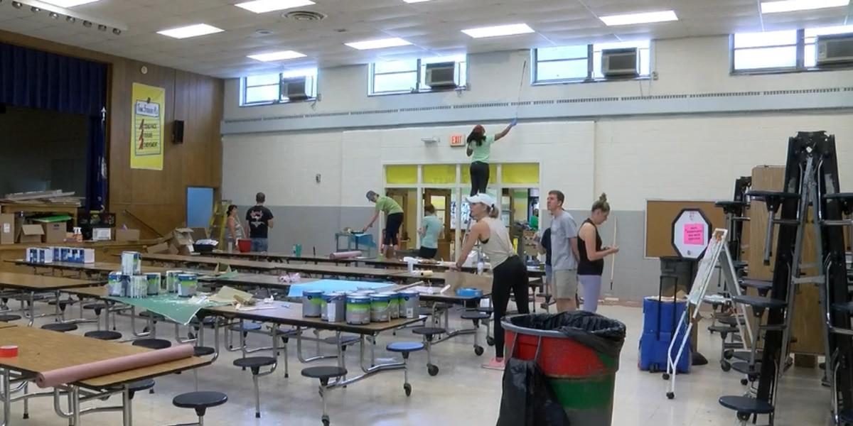 Staff, volunteers gather to clean, beautify RPS school