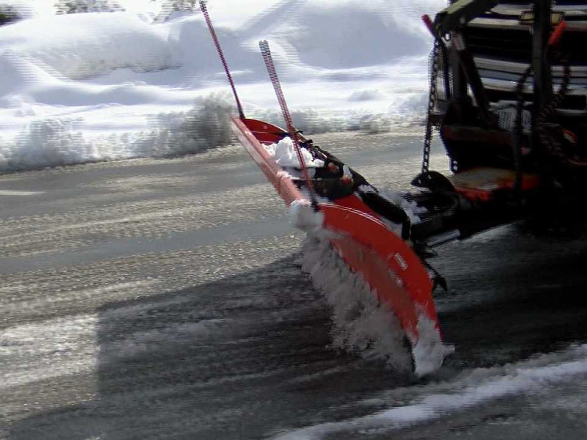 Snow plow services work hard to clear parking lots, businesses