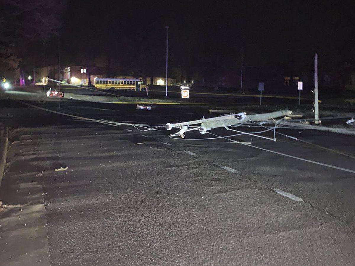 Car crashes, knocks down power pole