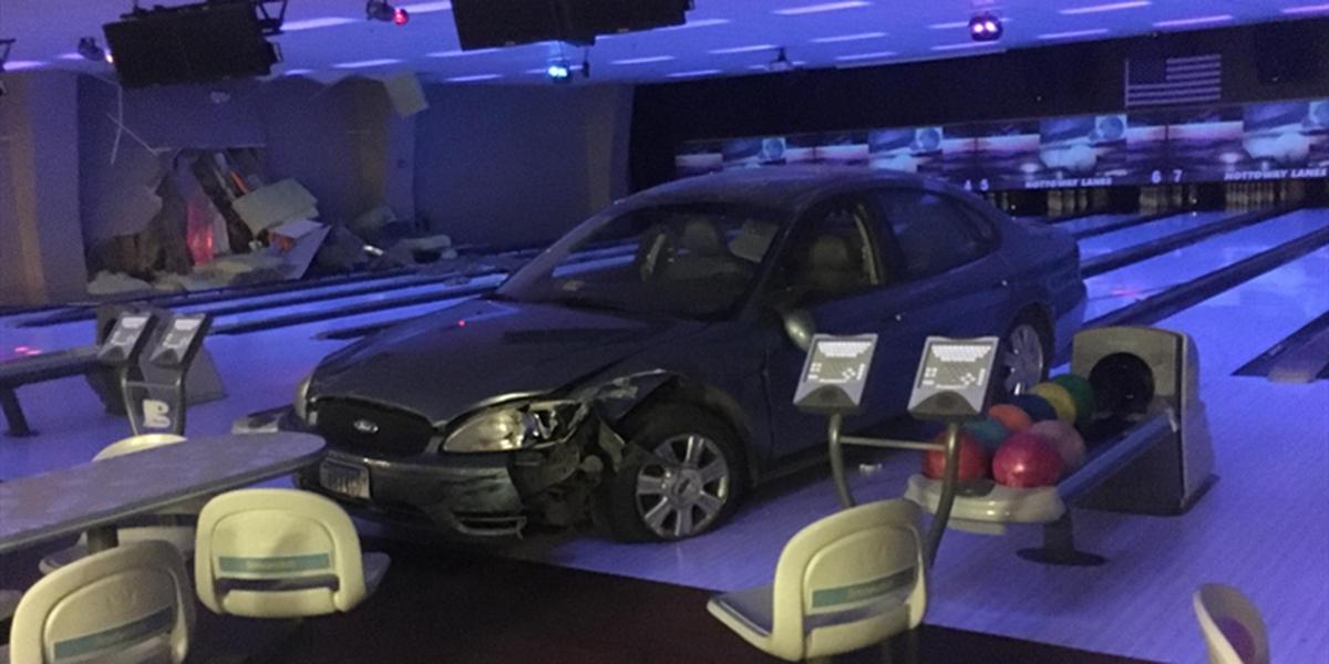 Car crashes through bowling alley