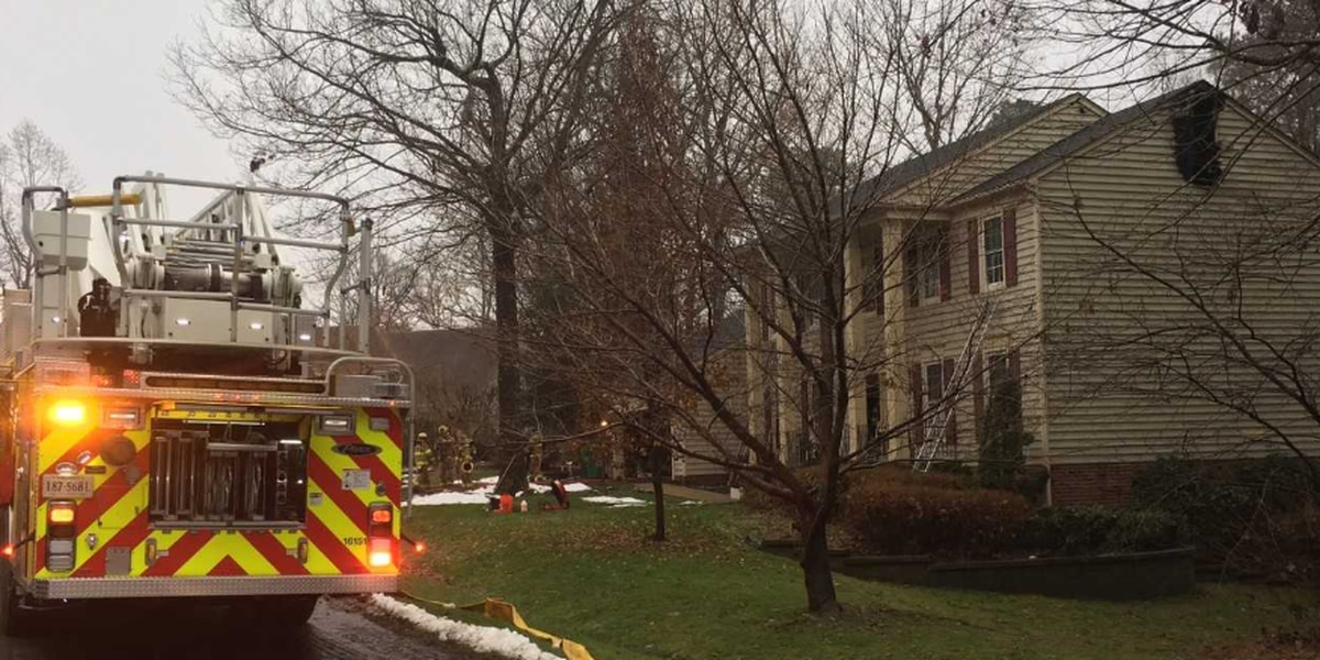 Neighbors help woman inside Chesterfield burning home; no injuries