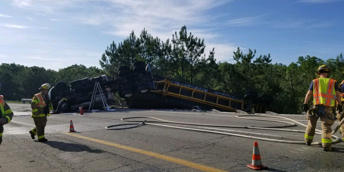 Tractor-trailer driver charged in crash that causes diesel, cargo spill