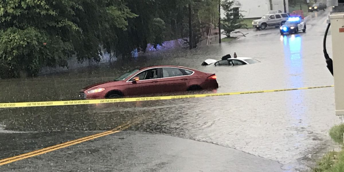 People rescued from vehicles after storms cause flooding