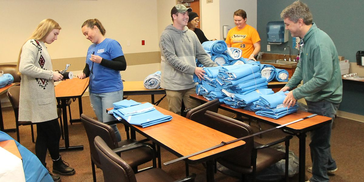 Volunteers, hospital workers stitch sleeping bags for the homeless