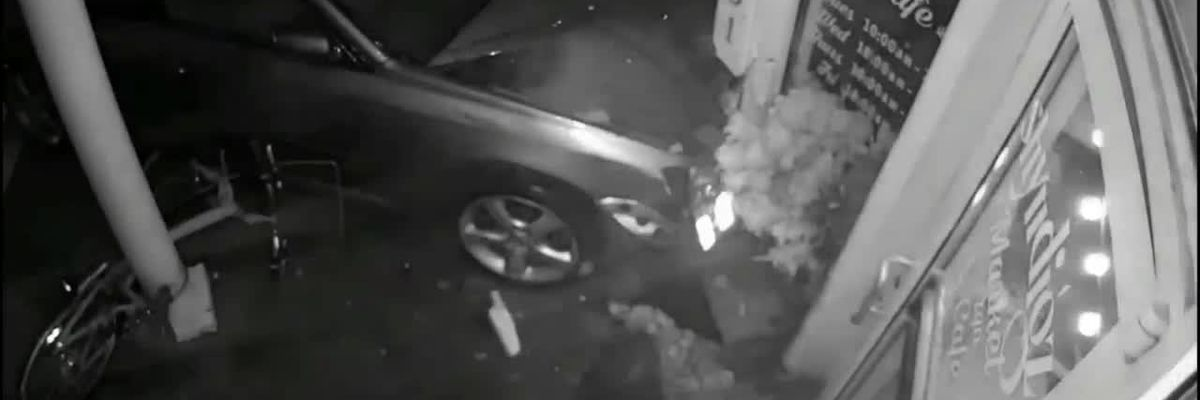 Video: Man crashes stolen car into woman, building