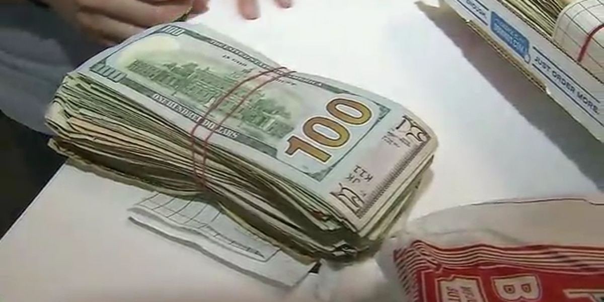 Woman opens Domino's box, finds thousands in cash inside