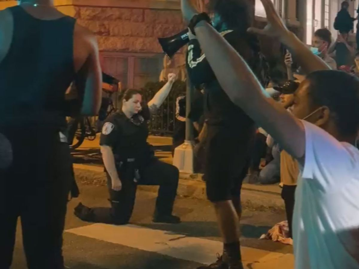 Signs of Unity: Richmond police kneel with protesters