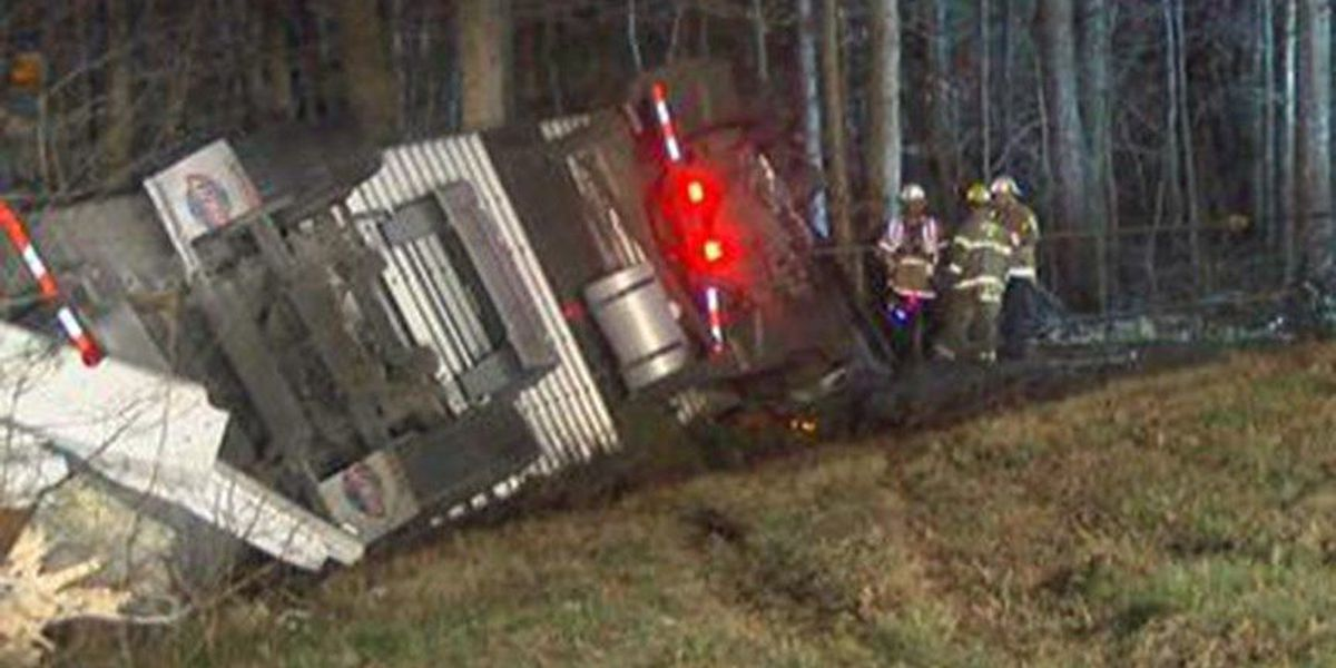 Tractor trailer carrying 32,000 pounds of frozen chickens overturns on I-295 ramp