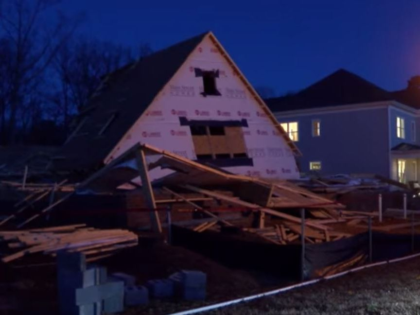 6 workers escape harm when two-story house collapses