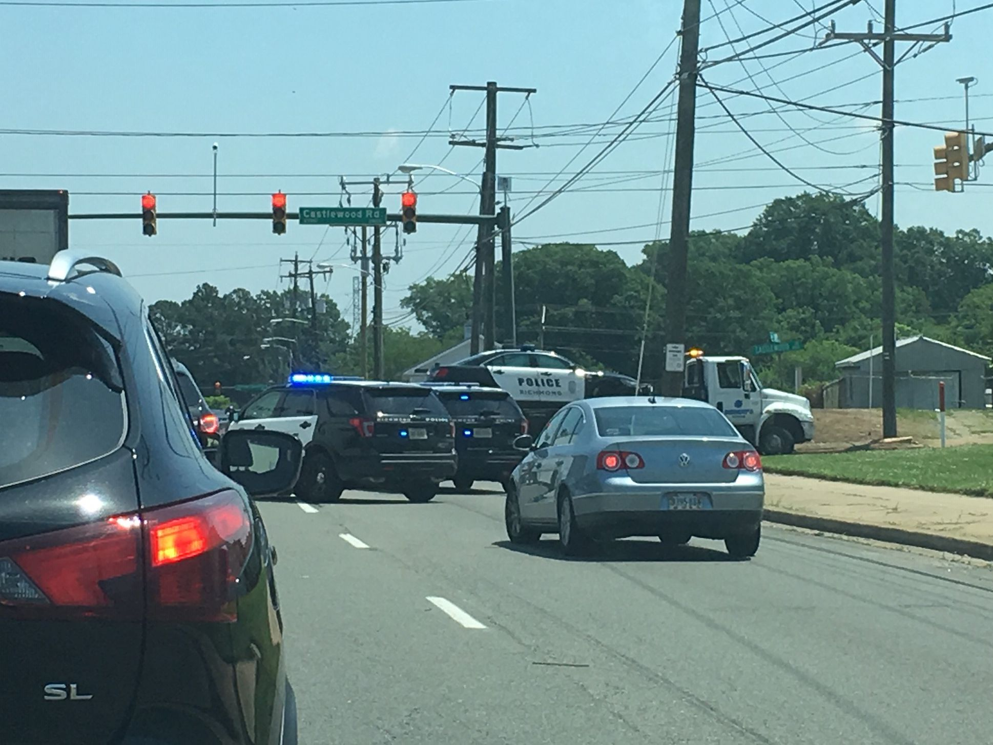 Driver charged after striking Richmond police vehicle