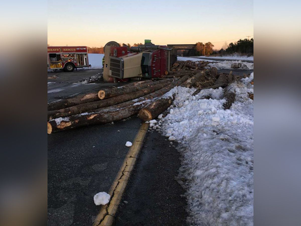 Logging truck overturns, spills logs after rear-ending farm tractor