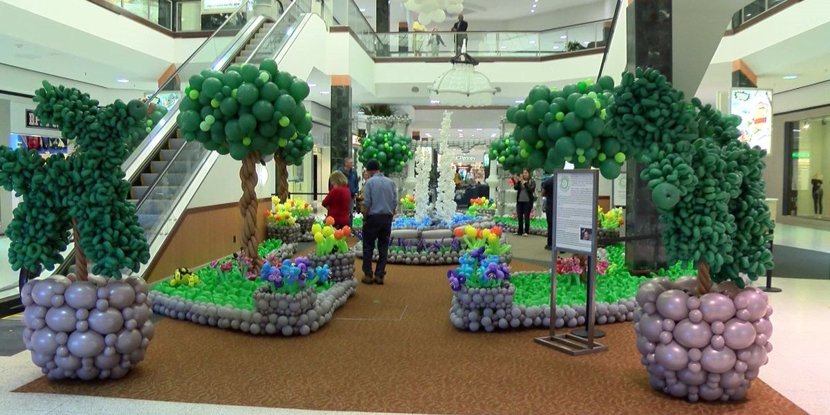 Artists help woman with cancer to create enchanted balloon garden