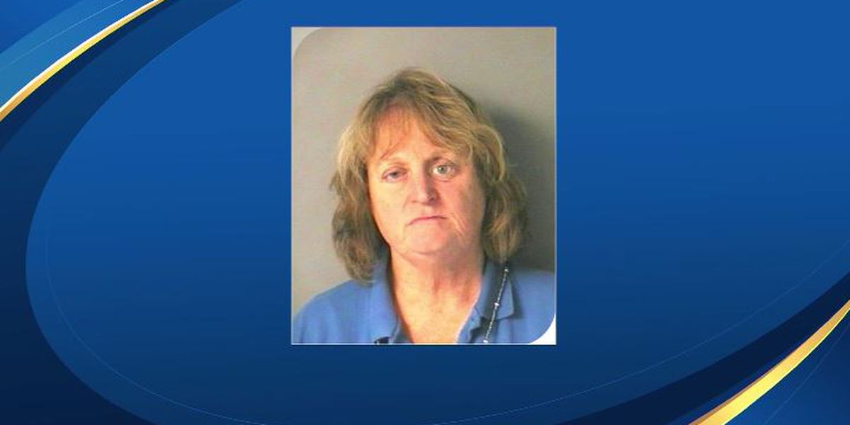 Woman accused of pushing golden retriever into lake, watching it drown