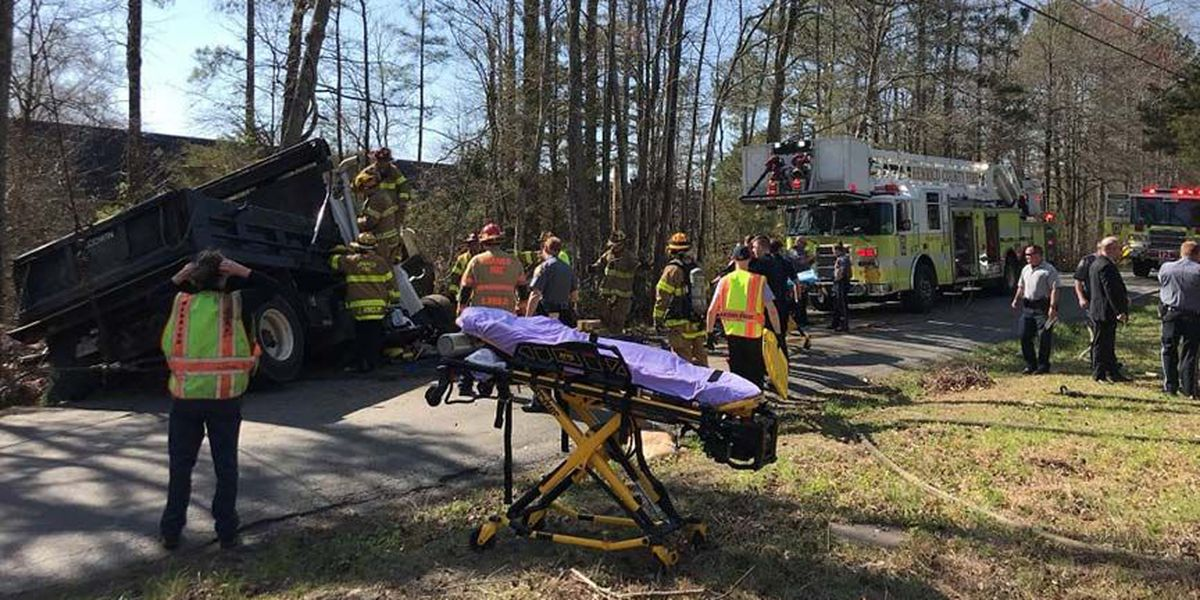 Person stuck in dump truck after crash; Med-Flight on scene