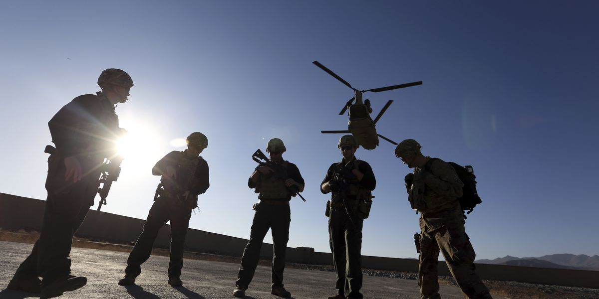 US pauses Afghanistan deployments, isolates arrivals there