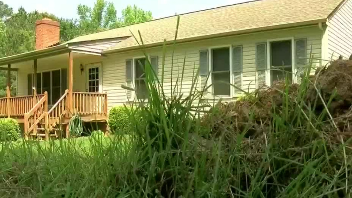 Couple relieved after yard damaged by postal service repaired