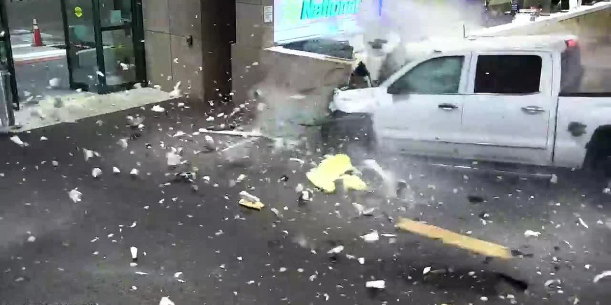 Surveillance video shows driver of pickup truck smashing through wall and into baggage claim at Sarasota, Fla. Airport