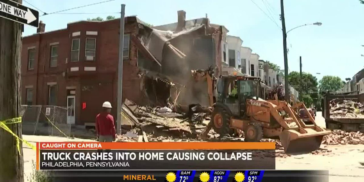 Truck crashes into home causing collapse