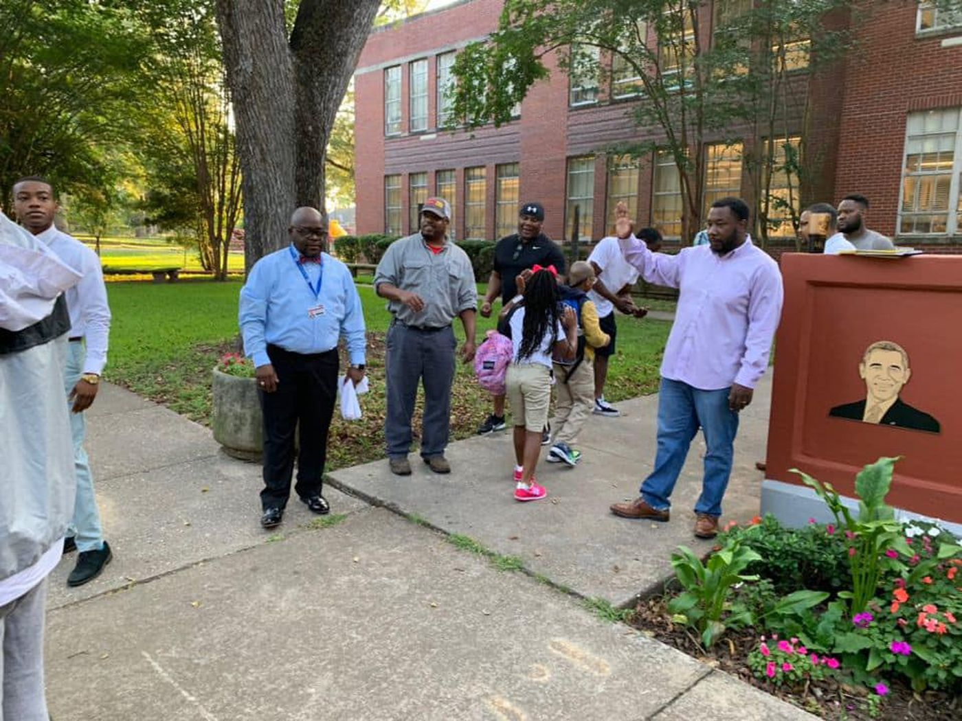 Dads line up to greet students on first day at Jackson