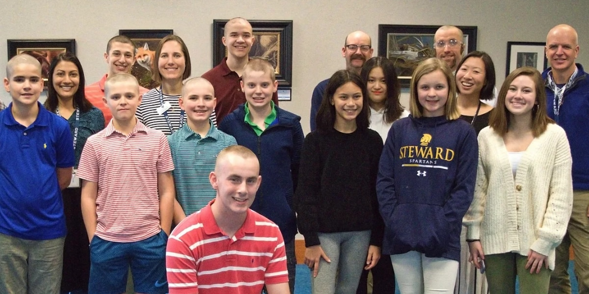 Students shave heads to raise money, awareness for childhood cancer