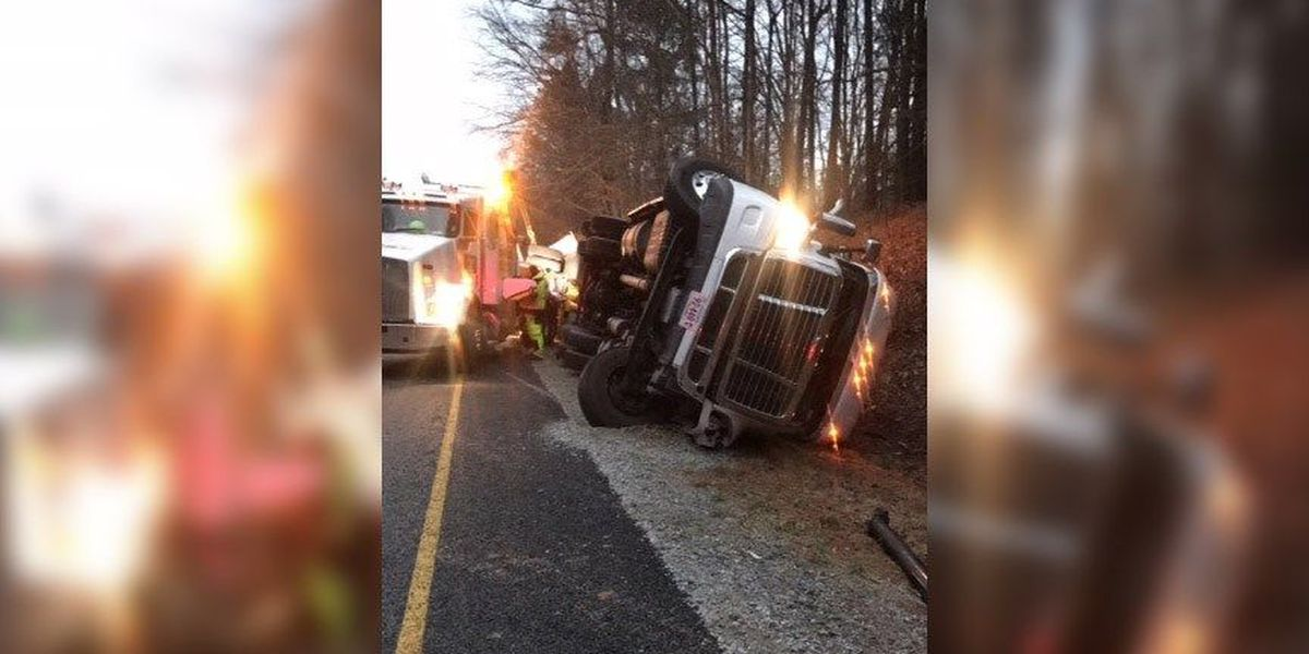 Tractor-trailer carrying 27,000 pounds of salmon overturns on I-85 in Dinwiddie