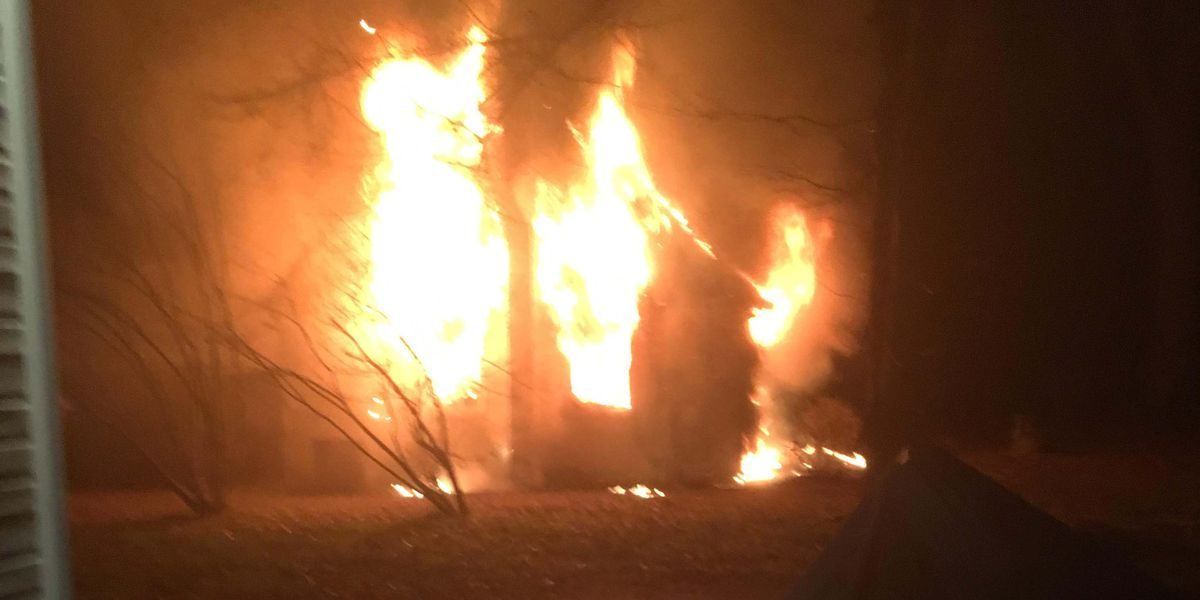 Woman injured in early morning house fire