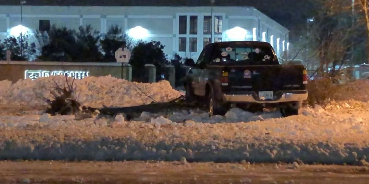 Truck slides into median late Monday night