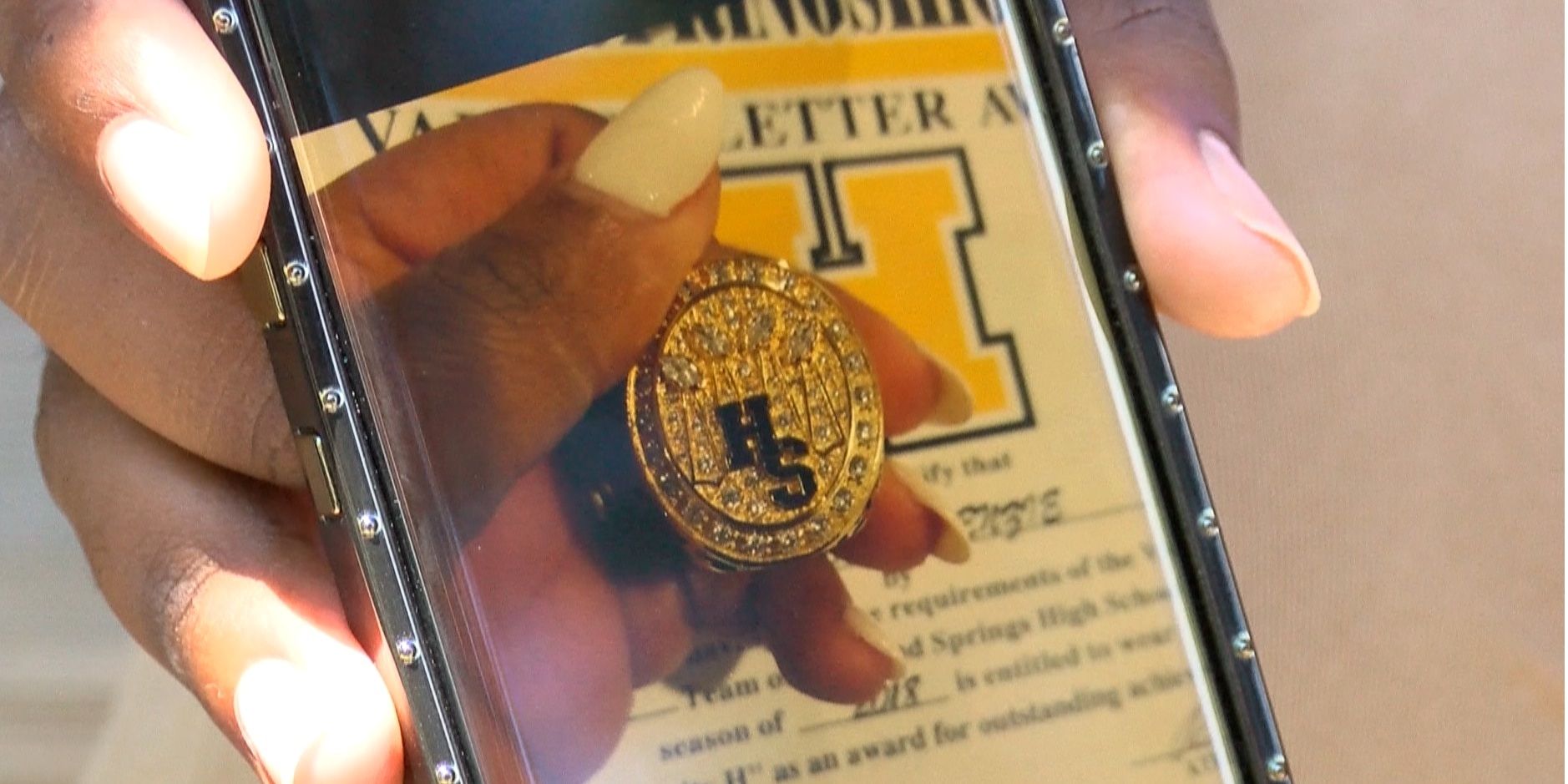Football player's championship ring stolen out of car