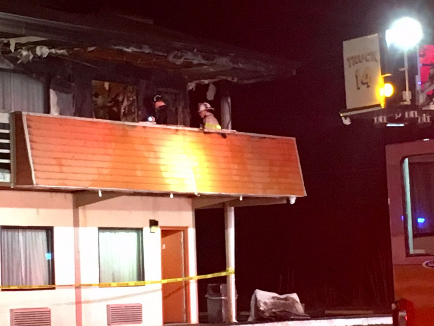 1 person fighting for life, 3 officers sent to hospital in motel fire
