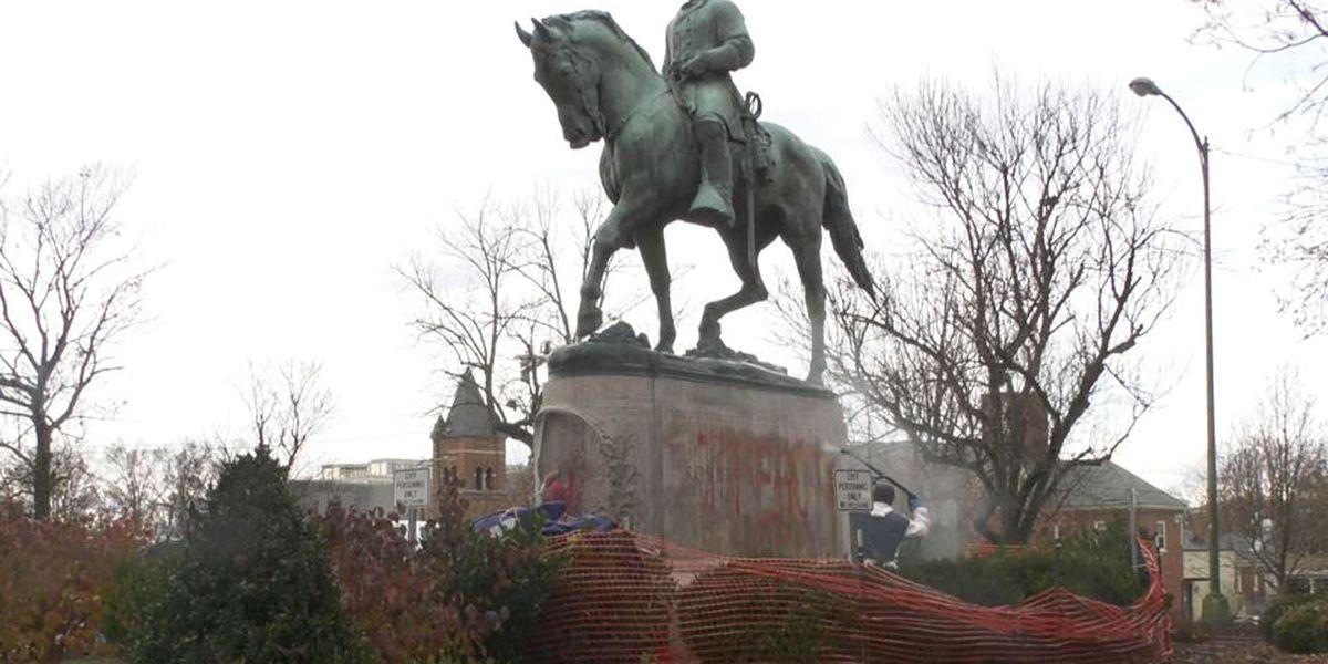 Charlottesville crews working to remove graffiti on Confederate statues