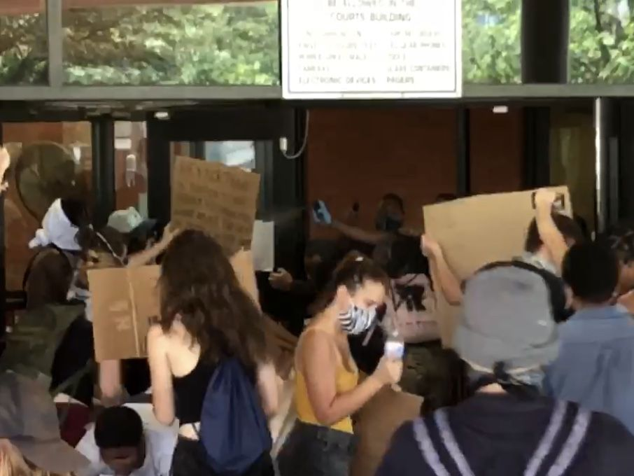 Eviction protest turns violent as crowd is pepper-sprayed by deputies; courthouse damaged