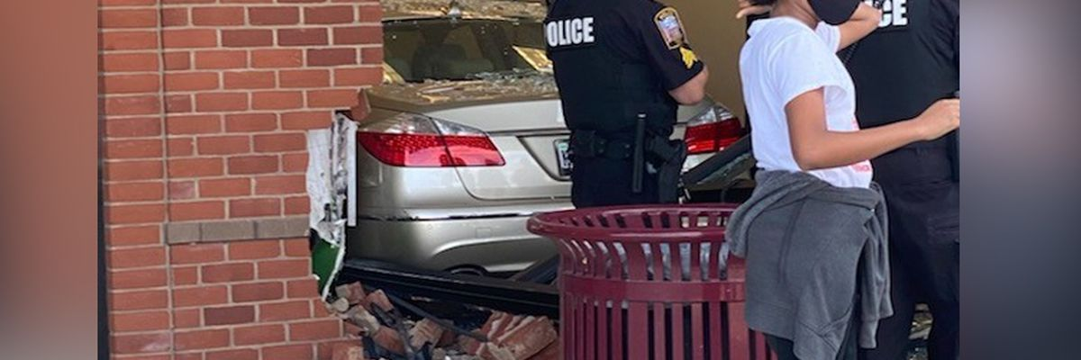 Four injured after car crashes into Chesterfield shopping center building