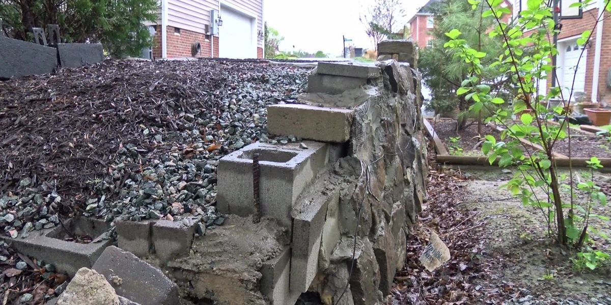 Homeowner calls 12, says neighbor built wall on his property