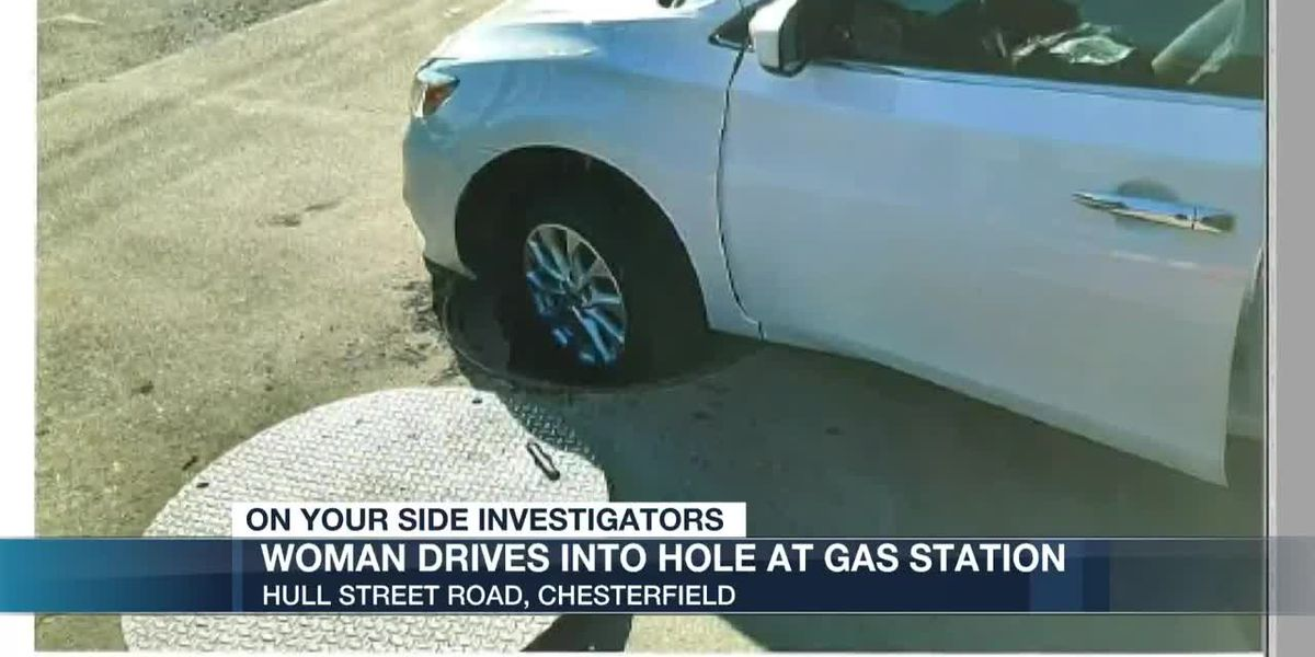 Woman drives into hole at gas station