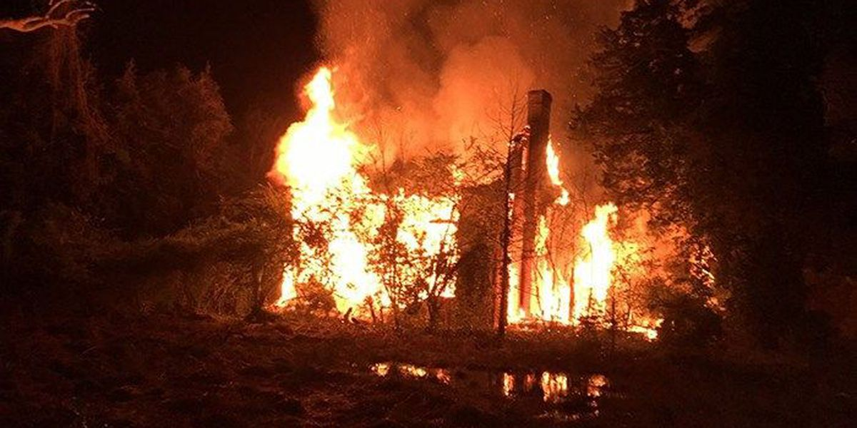 Firefighters battle blaze at three-story home