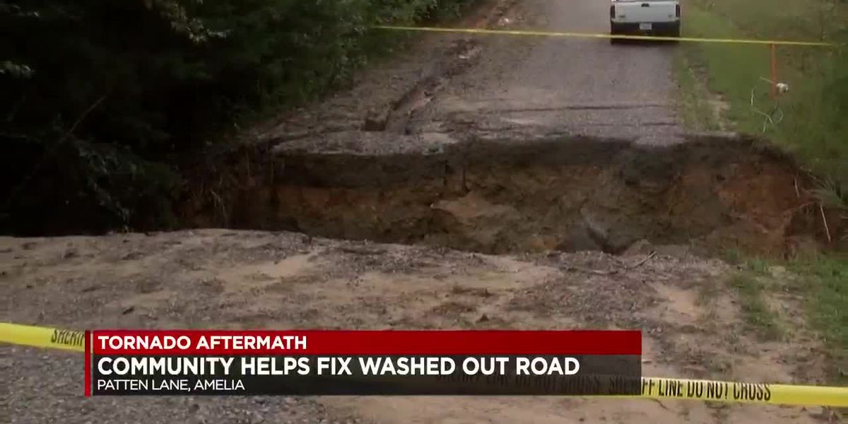 Community helps fix washed out road