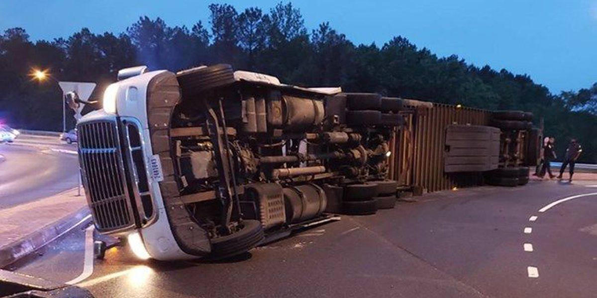 Tractor-trailer hauling recyclable material overturns in roundabout