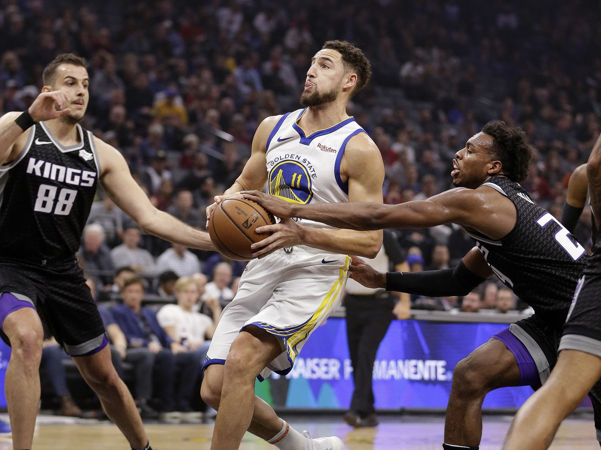 Curry, Thompson help Warriors beat Kings 130-125