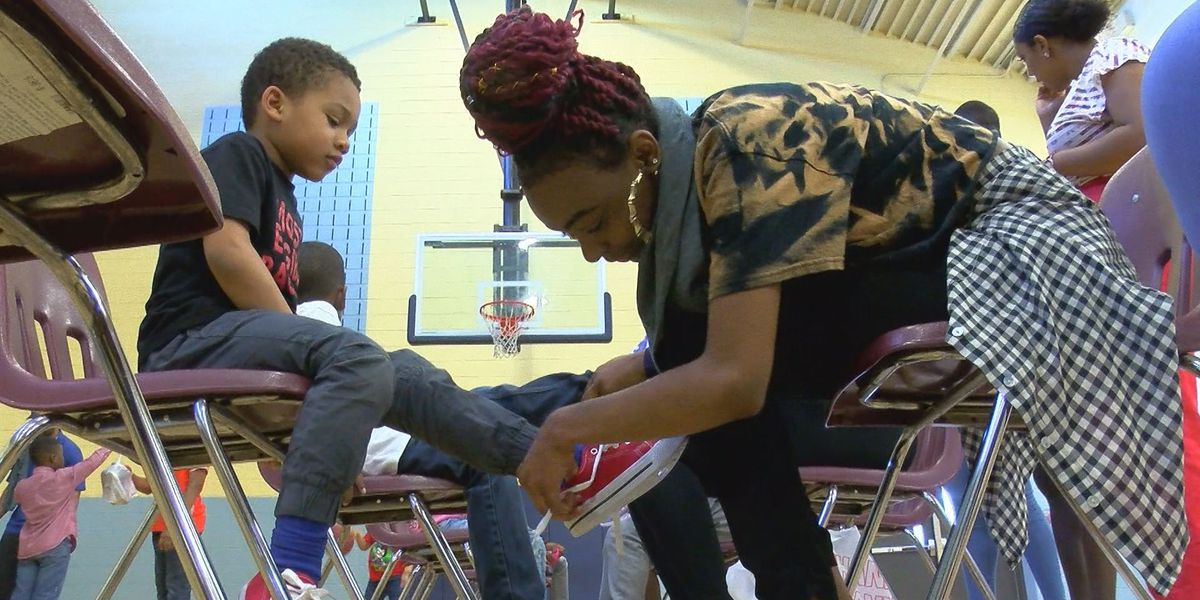 Elementary schoolers gifted new shoes, socks