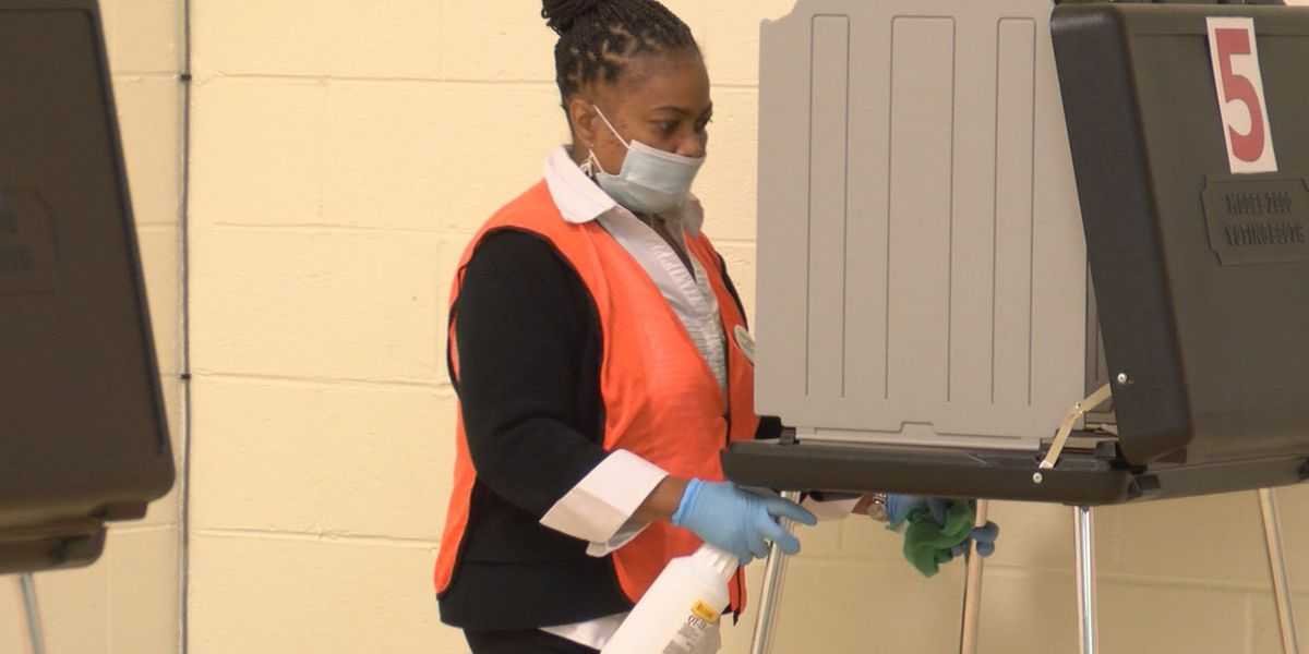 Voters cast their ballots with coronavirus safety precautions in place