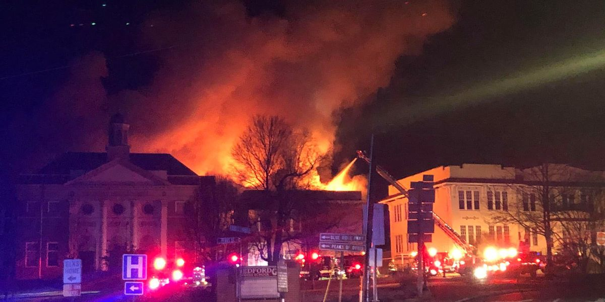 Crews fighting fire at old Bedford middle school