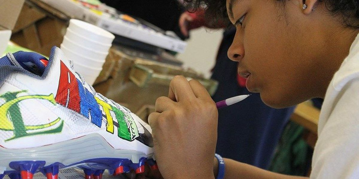 Students paint cleats with anti-bullying message for NY Giants player