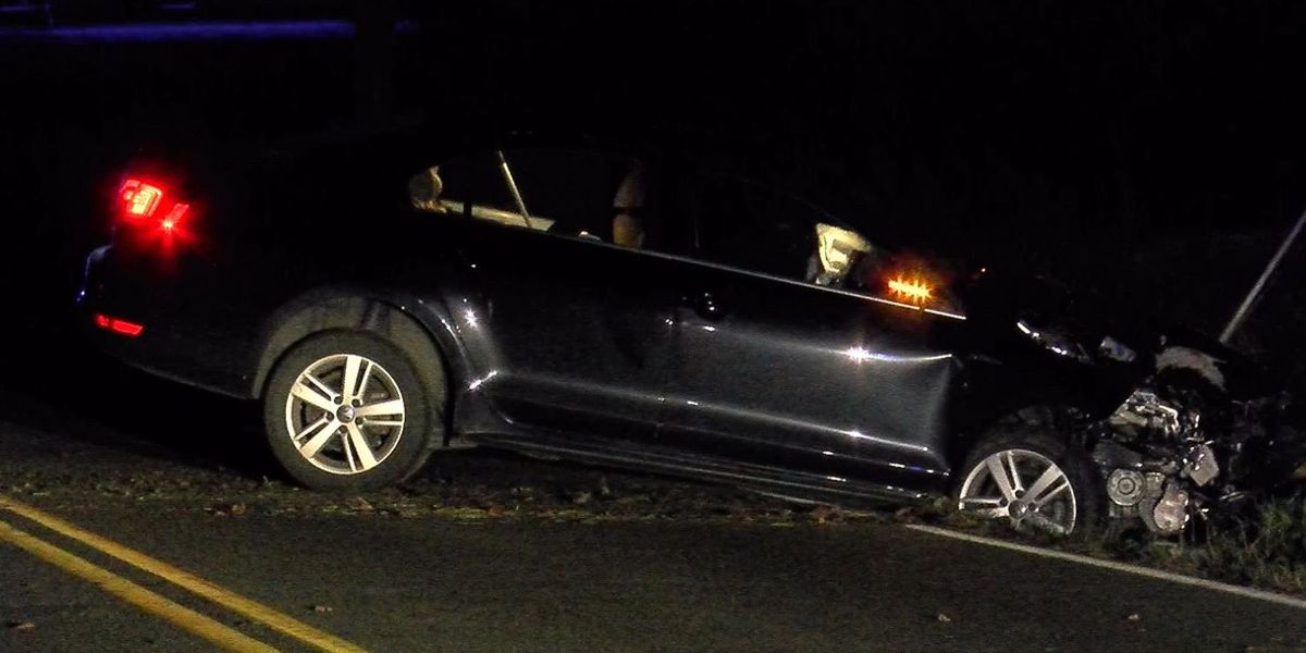 Car strikes utility pole; power outages restored