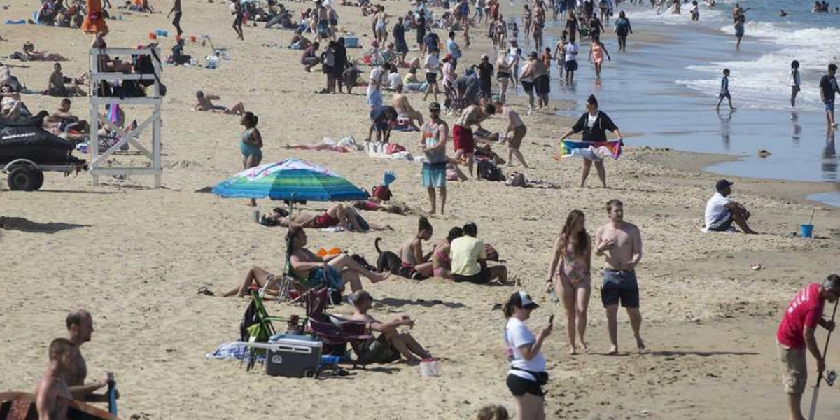 Weather draws crowds to closed Virginia Beach oceanfront